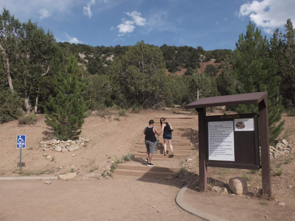 Nate Carlisle  |  The Salt Lake Tribune  Two hikers start up the trail to Kanarraville Falls on the afternoon of July 3, 2016. It's 3.5 miles to the first falls. A sign at the trailhead warns the hike is difficult.