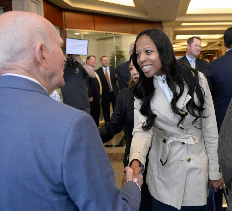 Al Hartmann  |  The Salt Lake Tribune Congresswoman Mia Love shakes hands with with Gene Hughes one of the three original founders of Natures Sunshine at a 45th anniversary celebration at the company headquarters in Lehi Tuesday April 11.