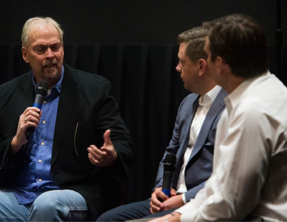 "Rick Egan     The Salt Lake Tribune  Tribune columnist Gordon Monson leads a discussion with Utah Jazz President Steve Starks, and Jazz General Manager Dennis Lindsey, during a ""Back to the Playoffs""  discussion sponsored by the Tribune, at the Gateway Megaplex Theaters, April 11, 2017."