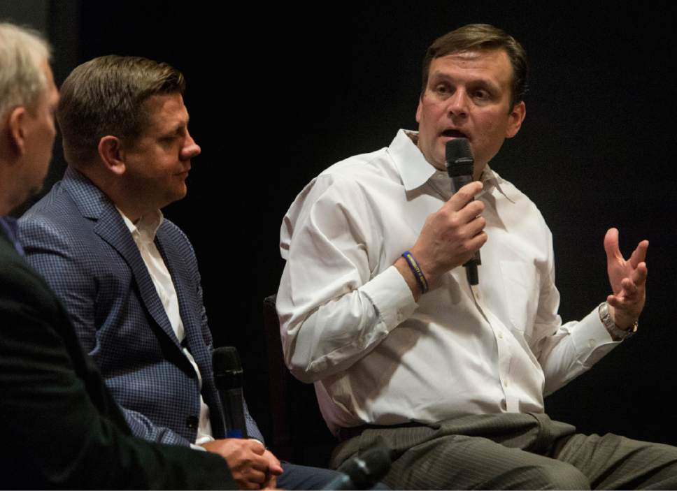 """Rick Egan     The Salt Lake Tribune  Utah Jazz General Manager Dennis Lindsey, makes a comment  during a discussion with Salt Lake Tribune columnist Gordon Monson, and Utah Jazz President Steve Starks, during a """"Back to the Playoffs"""" discussion sponsored by the Tribune, at the Gateway Megaplex Theaters, April 11, 2017."""