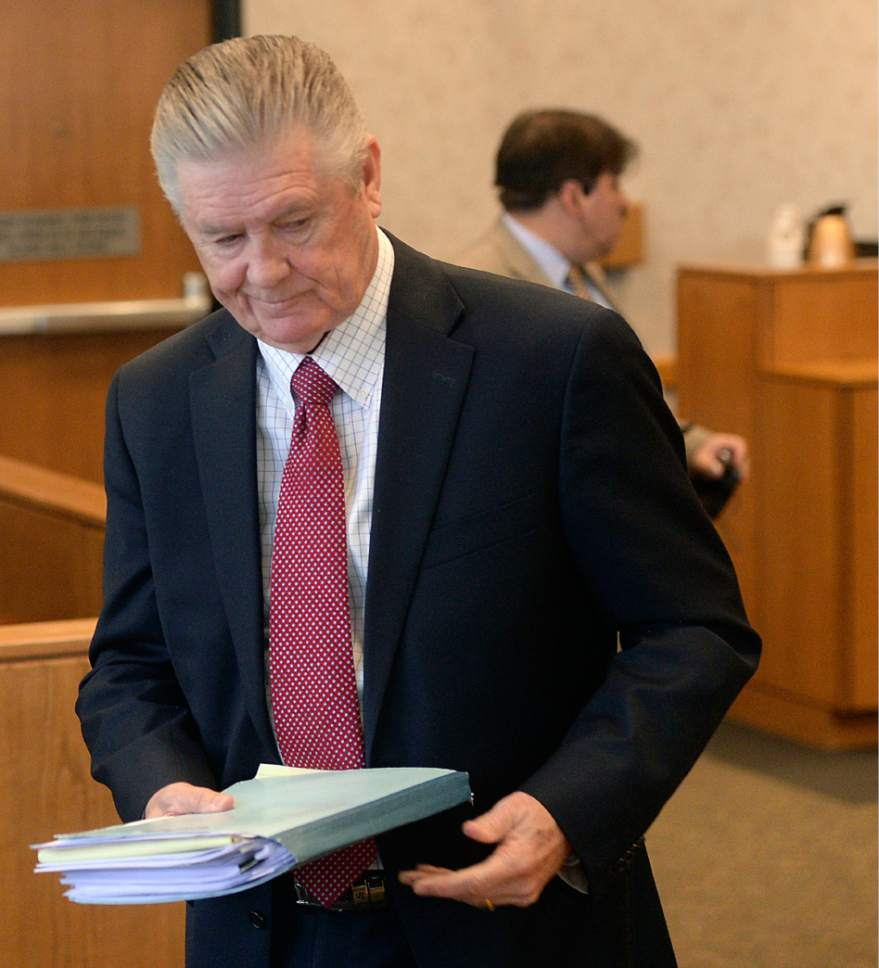 Al Hartmann     The Salt Lake Tribune Defense lawyer, Mike Esplin, leaves Judge Christine Johnson's courtroom in Provo Thursday April 13 after representing his client  Luke Dollahite, 16.   Dollahite plead guilty to one count of attempted aggravated murder for a locker-room knife rampage last year at an Orem high school.