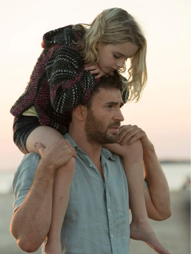 """In this image released by Fox Searchlight Pictures, McKenna Grace, left, and Chris Evans appear in a scene from, """"Gifted."""" (Wilson Webb/Fox Searchlight Pictures via AP)"""