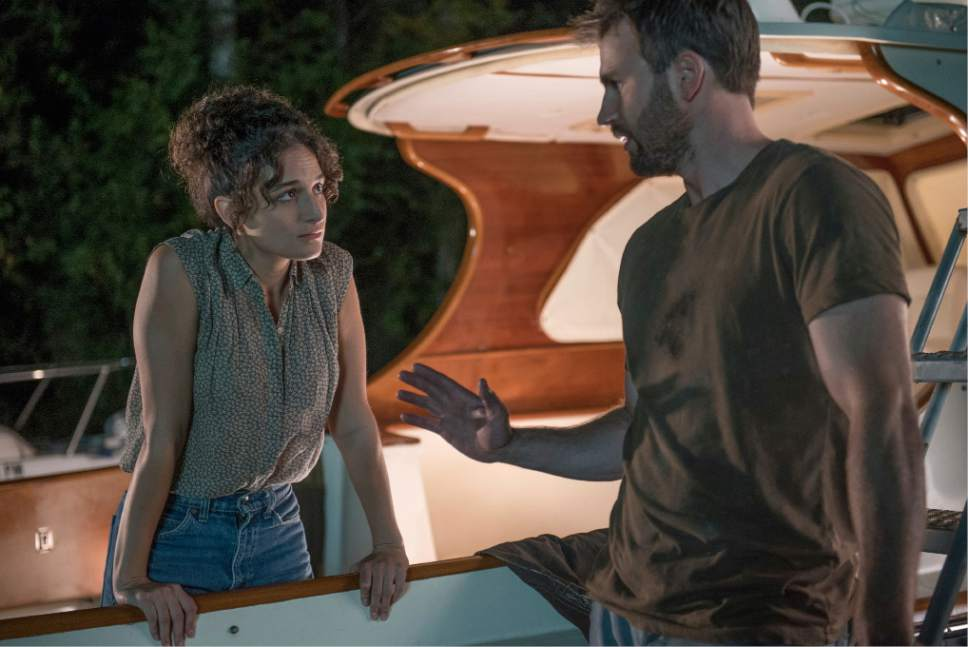 """In this image released by Fox Searchlight Pictures, Jennie Slate, left, and Chris Evans appear in a scene from, """"Gifted."""" (Wilson Webb/Fox Searchlight Pictures via AP)"""