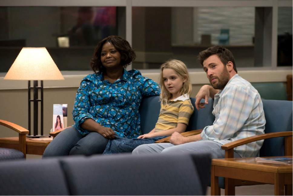 """In this image released by Fox Searchlight Pictures, Octavia Spencer, from left, McKenna Grace and Chris Evans appear in a scene from, """"Gifted."""" (Wilson Webb/Fox Searchlight Pictures via AP)"""