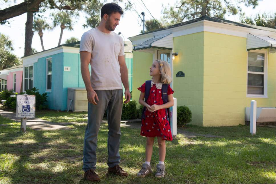 """In this image released by Fox Searchlight Pictures, Chris Evans, left, and McKenna Grace appear in a scene from, """"Gifted."""" (Wilson Webb/Fox Searchlight Pictures via AP)"""