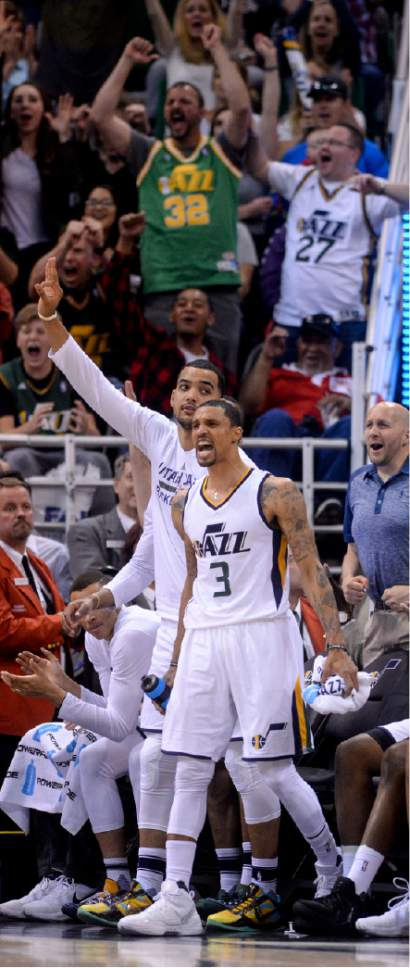 Steve Griffin  |  The Salt Lake Tribune   Utah Jazz guard George Hill (3) jumps off the bench and screams with the fans as the Jazz reserves battle the Spurs reserves in the final minutes of the last game of the 2017 season at Vivint Smart Home Arena in Salt Lake City Wednesday April 12, 2017.