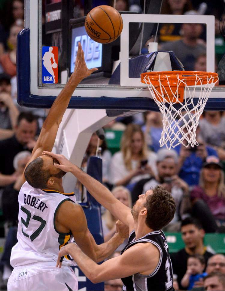 Steve Griffin  |  The Salt Lake Tribune   Utah Jazz center Rudy Gobert (27) gets smacked in the face by San Antonio Spurs center Pau Gasol (16) during the final game of the 2017 season at Vivint Smart Home Arena in Salt Lake City Wednesday April 12, 2017.