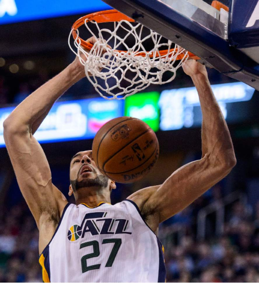 Steve Griffin  |  The Salt Lake Tribune   Utah Jazz center Rudy Gobert (27) throws down a dunk during the final game of the 2017 season against the San Antonio Spurs at Vivint Smart Home Arena in Salt Lake City Wednesday April 12, 2017.