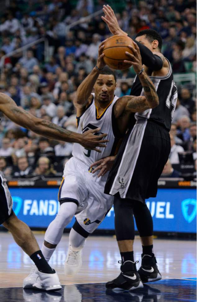 Steve Griffin  |  The Salt Lake Tribune  Utah Jazz guard George Hill (3) drives past San Antonio Spurs guard Danny Green (14) during the final game of the 2017 season at Vivint Smart Home Arena in Salt Lake City Wednesday April 12, 2017.