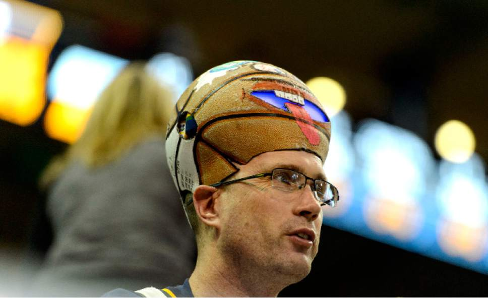 Steve Griffin  |  The Salt Lake Tribune   Jeff Profit, of Cedar Hills, cheers on the Jazz wearing a basketball on his head prior to the tip-off of the final game of the 2017 season against the San Antonio Spurs at Vivint Smart Home Arena in Salt Lake City Wednesday April 12, 2017.