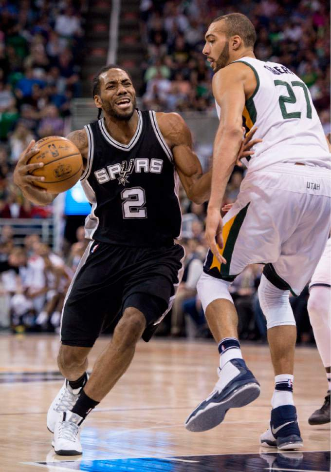 Steve Griffin  |  The Salt Lake Tribune   San Antonio Spurs forward Kawhi Leonard (2) grimaces as he is fouled by Utah Jazz center Rudy Gobert (27) during the final game of the 2017 season at Vivint Smart Home Arena in Salt Lake City Wednesday April 12, 2017.