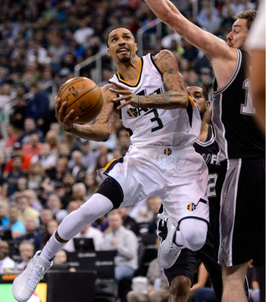 Steve Griffin  |  The Salt Lake Tribune   Utah Jazz guard George Hill (3) gets to the lane as he shoots over San Antonio Spurs guard Danny Green (14) during the final game of the 2017 season at Vivint Smart Home Arena in Salt Lake City Wednesday April 12, 2017.