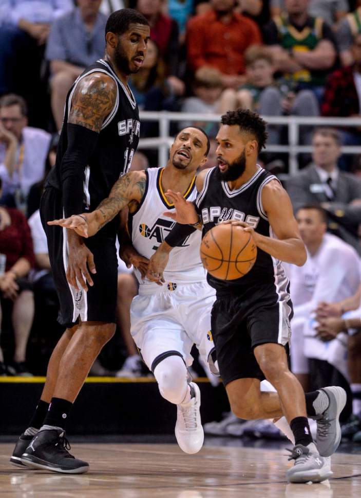 Steve Griffin  |  The Salt Lake Tribune   Utah Jazz guard George Hill (3) runs into a pick set by San Antonio Spurs forward LaMarcus Aldridge (12) as San Antonio Spurs guard Patty Mills (8) dribbles at the top of the key during the final game of the 2017 season at Vivint Smart Home Arena in Salt Lake City Wednesday April 12, 2017.