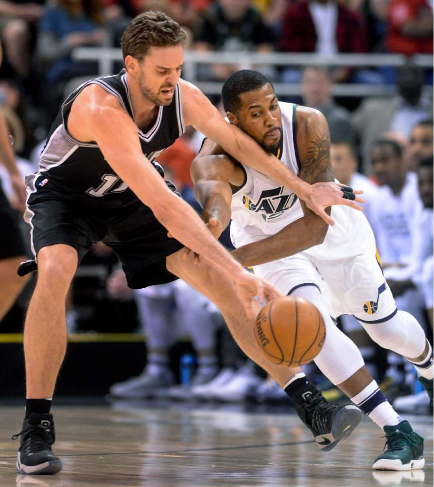 Steve Griffin  |  The Salt Lake Tribune   Utah Jazz forward Derrick Favors (15) stretches for the ball knocking it away form San Antonio Spurs center Pau Gasol (16) during the final game of the 2017 season at Vivint Smart Home Arena in Salt Lake City Wednesday April 12, 2017.