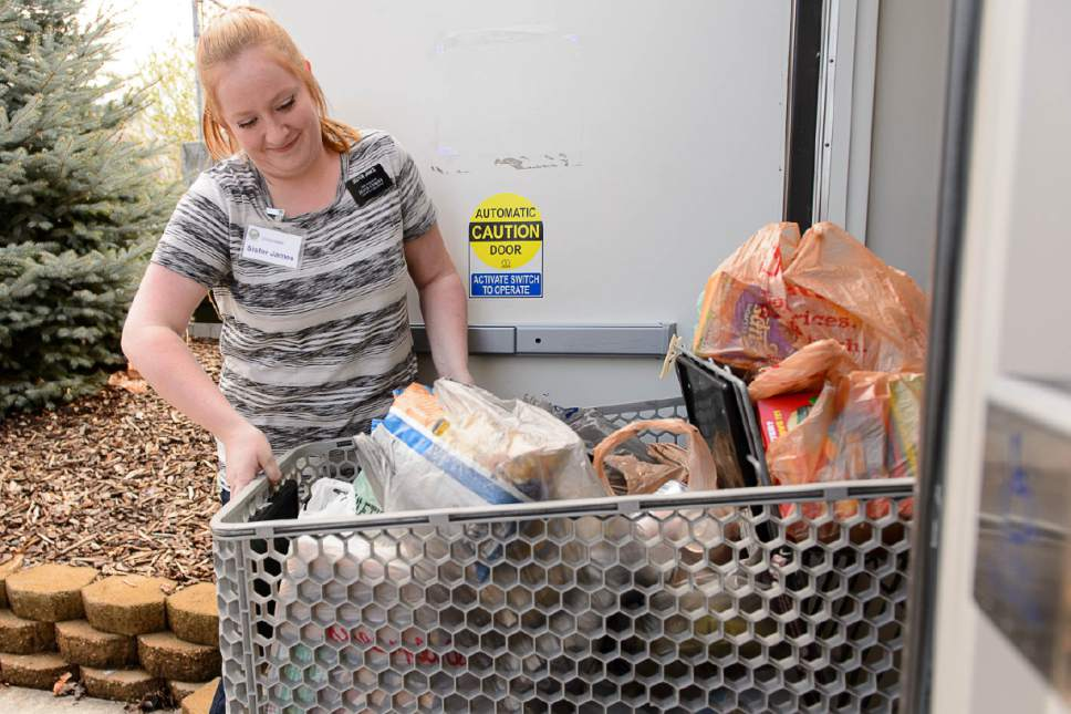 Trent Nelson  |  The Salt Lake Tribune Mya James, on a mission for the LDS Church, serves at the Bountiful Food Pantry, Tuesday, March 28, 2017.