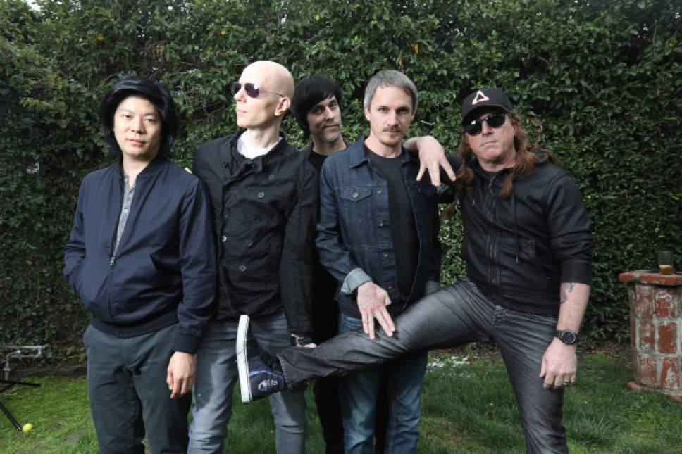 Rock band A Perfect Circle (from left: James Iha, Billy Howerdel, Matt McJunkins, Jeff Friedl and Maynard James Kennan) is on its first tour since 2011 and working on its first studio album since 2004. APC will perform at the Maverik Center in West Valley City on Saturday, April 15.  Courtesy Tim Cadiente