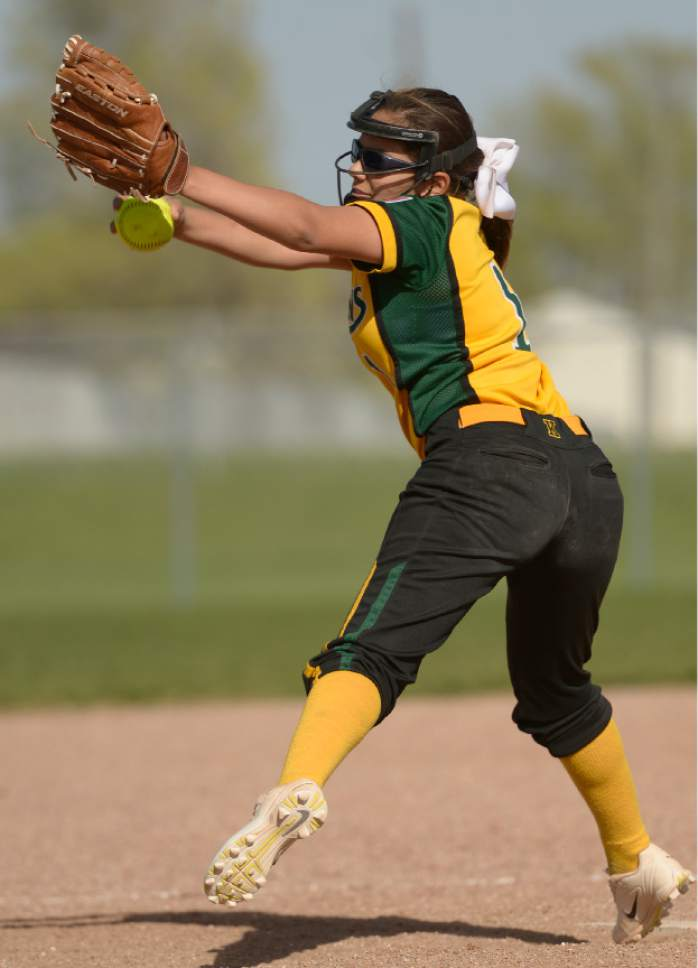 Leah Hogsten  |  The Salt Lake Tribune  Kearns' pitcher Angel Valdez. Cyprus High School girls' softball team defeated Kearns High School 5-0 during their game Thursday, April 13, 2017 in Magna.