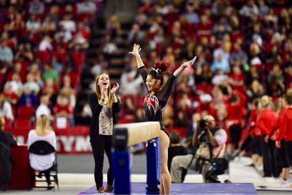 Utah Utes sophomore Kari Lee poses after her balance beam routine during their meet against Georgia on Saturday, March 11, 2017. The Utes fell to the Bulldogs 197.250-196.650, but Lee won the all-around and notched a career-high of 39.450. Courtesy Photo | Deena Lofgren/University of Utah