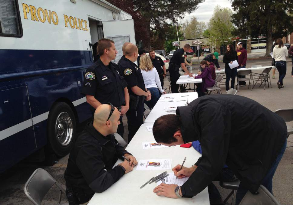 Scott Sommerdorf      Tribune file photo Volunteers sign upin April to search for Provo resident  Elizabeth Elena Laguna-Salgado, 26, who was last seen walking home April 16 from the Nomen Global Language School at 384 W. Center St.