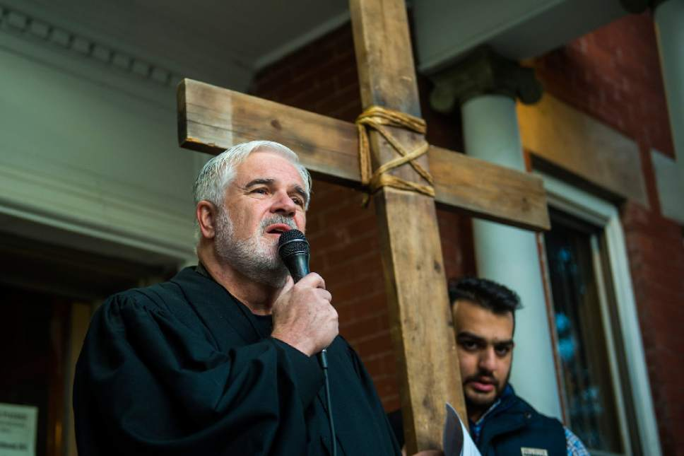 "Chris Detrick  |  The Salt Lake Tribune Rev. Michael J. Imperiale, Pastor of First Presbyterian Church, speaks at the Crossroads Urban Center during the annual Good Friday Procession of the Cross Saturday, April 15, 2017.  Since 1983, the Salt Lake Council of Churches has sponsored this annual procession, which is similar to the tradition of the ""Via Dolorosa"" (Way of Suffering), where pilgrims to Jerusalem follow the path Jesus took to the cross."