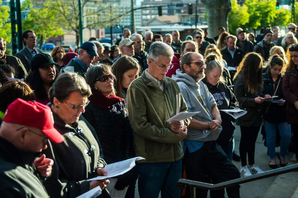 "Chris Detrick  |  The Salt Lake Tribune Participants sing outside of the Cathedral of the Madeline during the annual Good Friday Procession of the Cross Saturday, April 15, 2017.  Since 1983, the Salt Lake Council of Churches has sponsored this annual procession, which is similar to the tradition of the ""Via Dolorosa"" (Way of Suffering), where pilgrims to Jerusalem follow the path Jesus took to the cross."