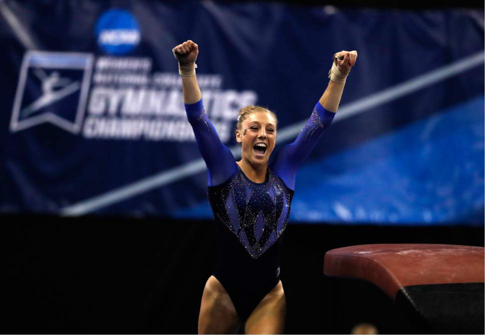 Florida's Alex McMurtry celebrates after competing on the vault during the NCAA college women's gymnastics championships Friday, April 14, 2017, in St. Louis. (AP Photo/Jeff Roberson)