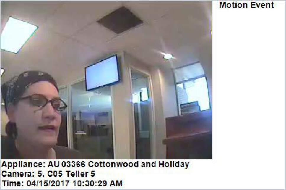 Provided A bank camera caught this footage of a woman who is suspected of robbing one bank Friday and five on Saturday. In each case, she passed the teller a note demanding money but didn't always get cash before fleeing.
