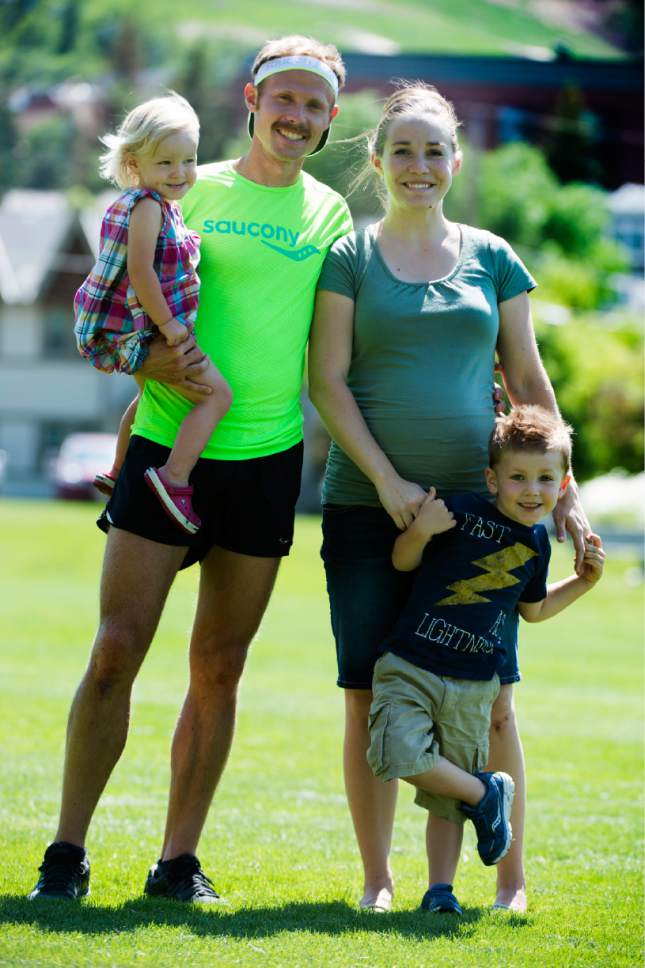 Rick Egan  |  The Salt Lake Tribune  Former BYU distance runner Jared Ward, holds their 2-year-old daughter Ellie, while his wife Erica holds their 4-year-old son Paul, on the Rail Trail in Park City, Tuesday, June 21, 2016.