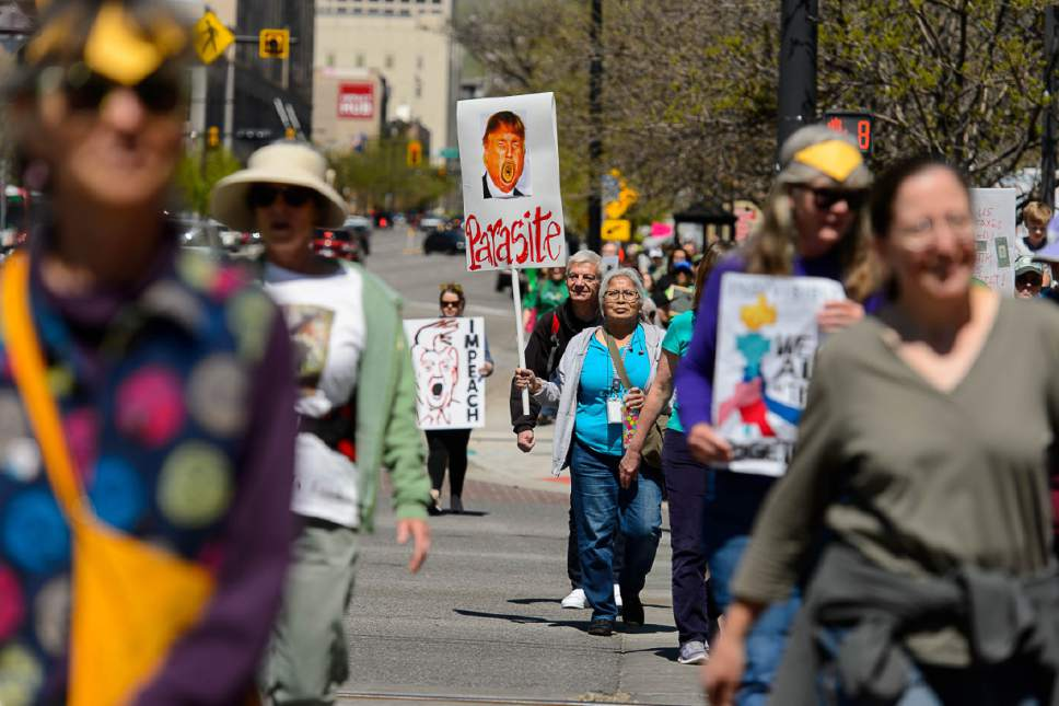Trent Nelson  |  The Salt Lake Tribune Participants march after a rally calling for President Trump to release his tax returns, which took place at the Salt Lake City and County Building, Saturday April 15, 2017.