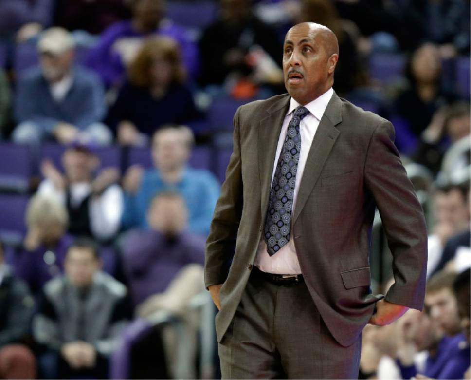 Washington coach Lorenzo Romar watches from the bench during the first half of the team's NCAA college basketball game against Colorado, Wednesday, Jan. 18, 2017, in Seattle. (AP Photo/Ted S. Warren)