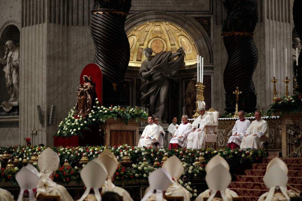 Pope Francis presides over a solemn Easter vigil ceremony in St. Peter's Basilica at the Vatican, Saturday, April 15, 2017. (AP Photo/Andrew Medichini)