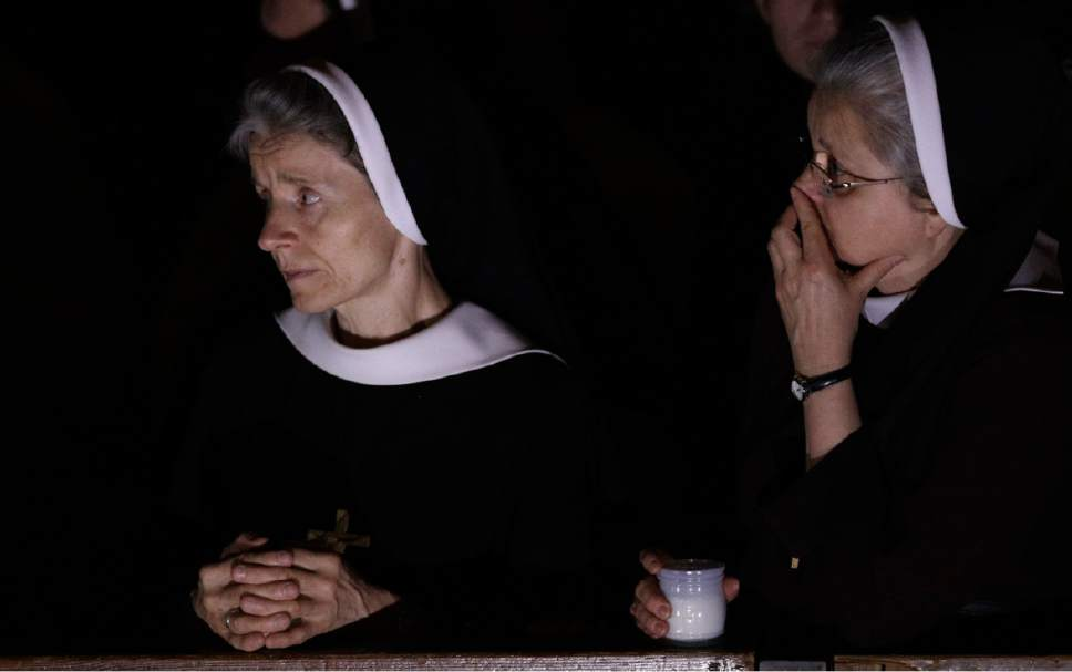 Nuns follow a solemn Easter vigil ceremony celebrated by Pope Francis, in St. Peter's Basilica at the Vatican, Saturday, April 15, 2017. (AP Photo/Andrew Medichini)