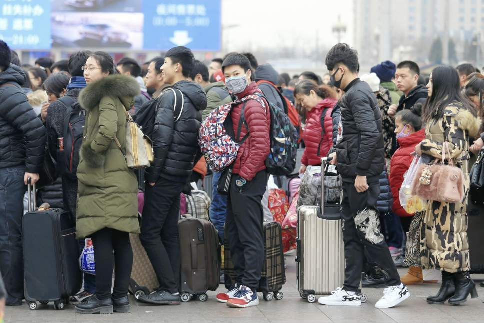 A photo shows Beijing Station crowded with people going home or traveling on Jan.18, 2017 ahead of Chinese New Year.( The Yomiuri Shimbun via AP Images )
