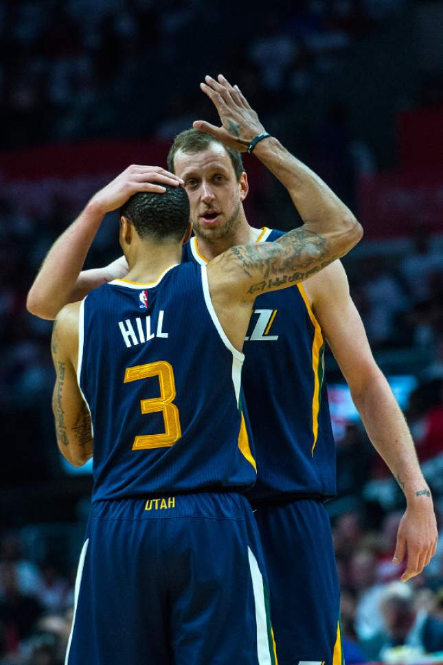 Chris Detrick  |  The Salt Lake Tribune Utah Jazz guard George Hill (3) and Utah Jazz forward Joe Ingles (2) embrace during Game 1 of the Western Conference at the Staples Center Saturday, April 15, 2017.  Utah Jazz defeated LA Clippers 97-95.