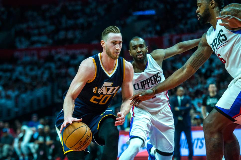 Chris Detrick  |  The Salt Lake Tribune Utah Jazz forward Gordon Hayward (20) runs past LA Clippers forward Luc Mbah a Moute (12) and LA Clippers center DeAndre Jordan (6) during Game 1 of the Western Conference at the Staples Center Saturday, April 15, 2017.  Utah Jazz defeated LA Clippers 97-95.