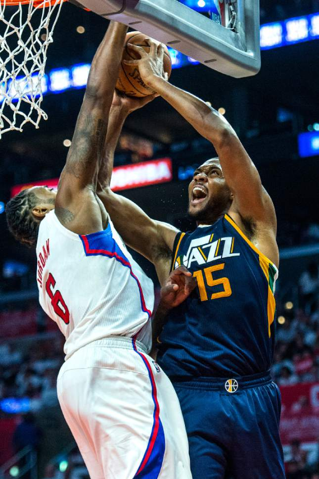Chris Detrick  |  The Salt Lake Tribune Utah Jazz forward Derrick Favors (15) shoots past LA Clippers center DeAndre Jordan (6) during Game 1 of the Western Conference at the Staples Center Saturday, April 15, 2017.  Utah Jazz defeated LA Clippers 97-95.