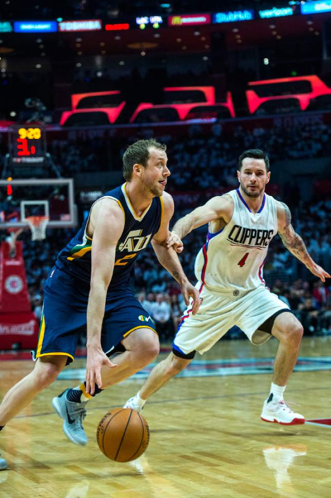 Chris Detrick  |  The Salt Lake Tribune Utah Jazz forward Joe Ingles (2) runs past LA Clippers guard JJ Redick (4) during Game 1 of the Western Conference at the Staples Center Saturday, April 15, 2017.  Utah Jazz defeated LA Clippers 97-95.