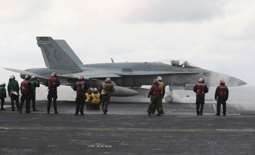 FILE - In this March 14, 2017 file photo, an F/A-18 fighter prepares to take off from the deck of the Nimitz-class aircraft carrier USS Carl Vinson during the annual joint military exercise called Foal Eagle between South Korea and the United States at an unidentified location in the international waters, east of the Korean Peninsula. North Korea is vowing tough counteraction to any military moves that might follow the U.S. Navy's decision to send the USS Carl Vinson aircraft carrier and its battle group to waters off the Korean Peninsula. (AP Photo/Lee Jin-man, File)