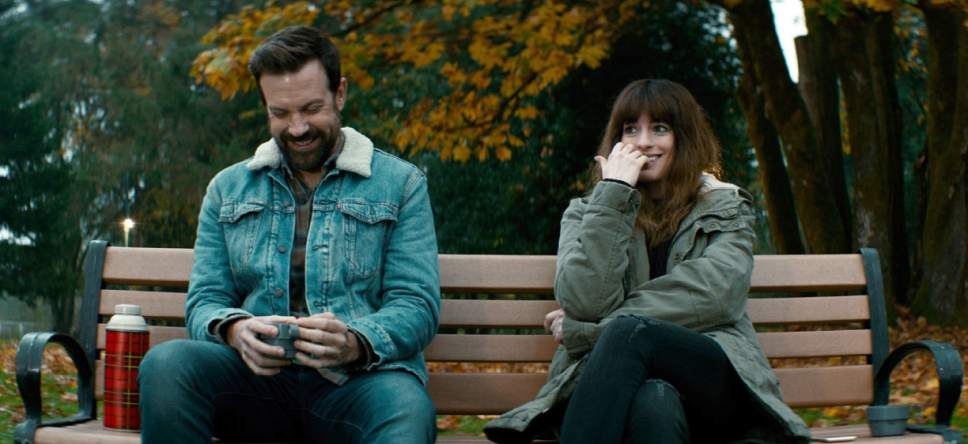 """In this image released by Neon, Jason Sudeikis, left, and Anne Hathaway appear in a scene from, """"Colossal."""" (Neon via AP)"""