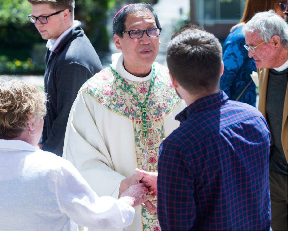 Rick Egan  |  The Salt Lake Tribune  The Most Reverend Oscar A. Solis' greets parishioners after Easter Mass, at the Cathedral of the Madeleine, Sunday, April 16, 2017.