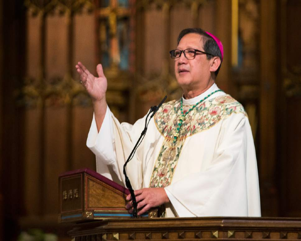 Rick Egan  |  The Salt Lake Tribune  The Most Reverend Oscar A. Solis' welcomes worshipers at the Easter Sunday of the Resurrection of the Lord Mass, at the Cathedral of the Madeleine, Sunday, April 16, 2017.