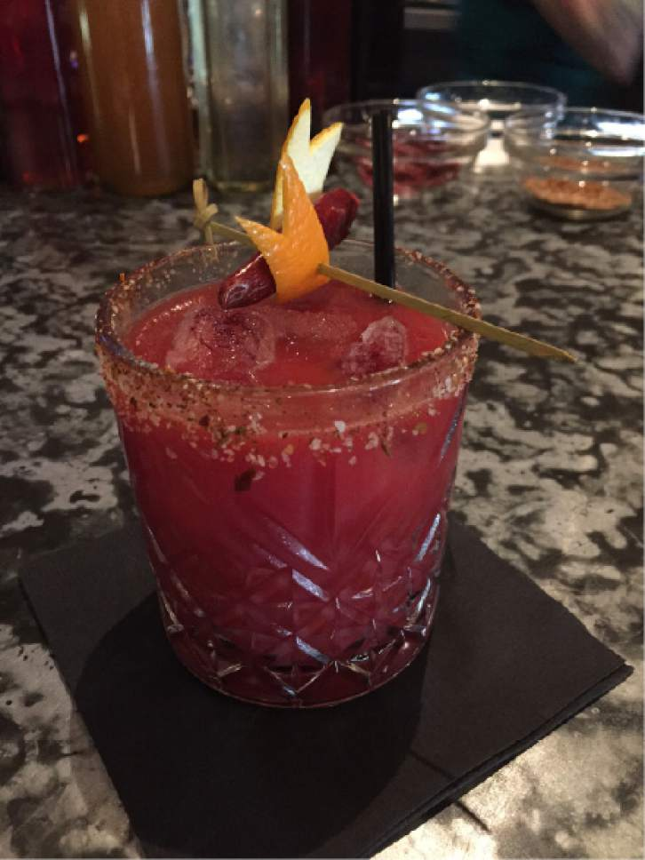 Kathy Stephenson  |  The Salt Lake Tribune  Goblin Valley Punch, with tequila, blood orange juice and mole bitters at Lake Effect Bar.