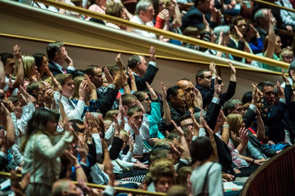 Chris Detrick  |  The Salt Lake Tribune Members affirm a vote during the afternoon session of the 187th Annual General Conference at the Conference Center in Salt Lake City Saturday, April 1, 2017.