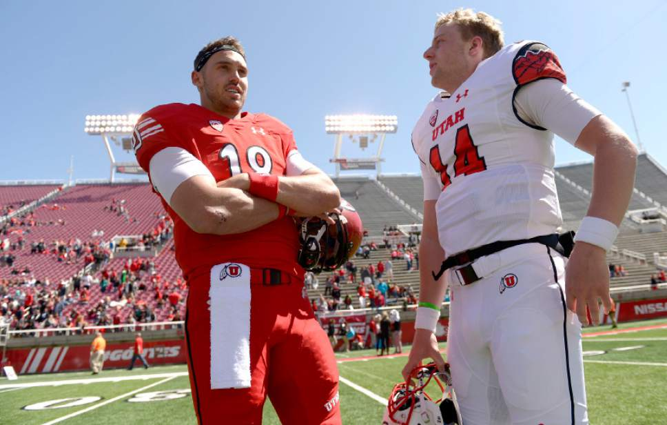 Leah Hogsten  |  The Salt Lake Tribune  l-r Quarterbacks Cooper Bateman and Drew Lisk discuss the game. The University of Utah Utes were back in action during the 16th-annual Red-White football game on Saturday, April 15, 2017 at  Rice-Eccles Stadium.