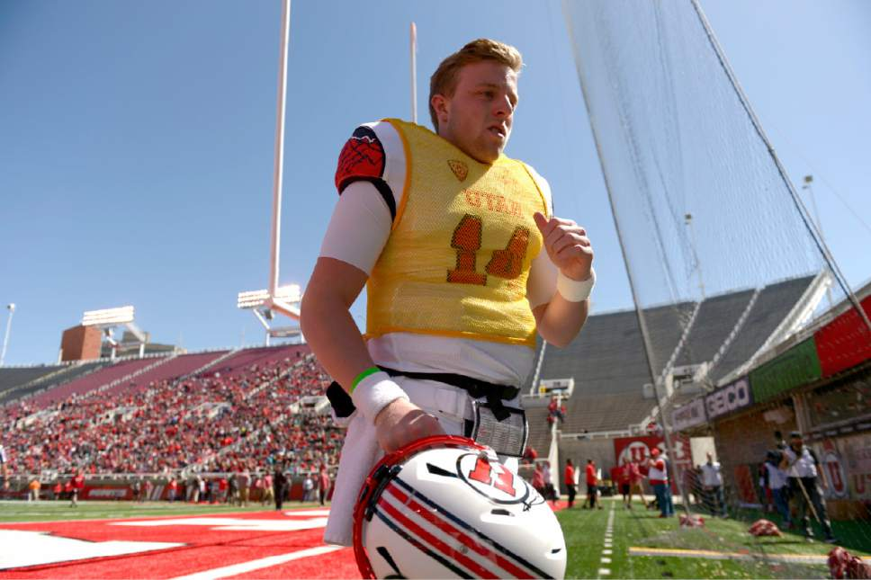 Leah Hogsten  |  The Salt Lake Tribune  Quarterback Drew Lisk leaves the field at halftime. The University of Utah Utes were back in action  during the 16th-annual Red-White football game on Saturday, April 15, 2017 at  Rice-Eccles Stadium.