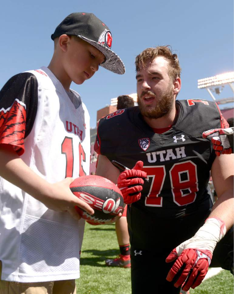 Leah Hogsten  |  The Salt Lake Tribune  Kohen Cunningham gets an autograph from Jake Grant after the game. The University of Utah Utes were back in action  during the 16th-annual Red-White football game on Saturday, April 15, 2017 at  Rice-Eccles Stadium.