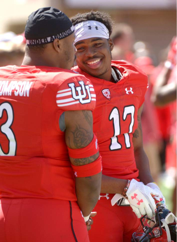 Leah Hogsten  |  The Salt Lake Tribune  Linebacker Donavan Thompson shares a laugh with wide receiver Demari Simpkins. The University of Utah Utes were back in action  during the 16th-annual Red-White football game on Saturday, April 15, 2017 at  Rice-Eccles Stadium.