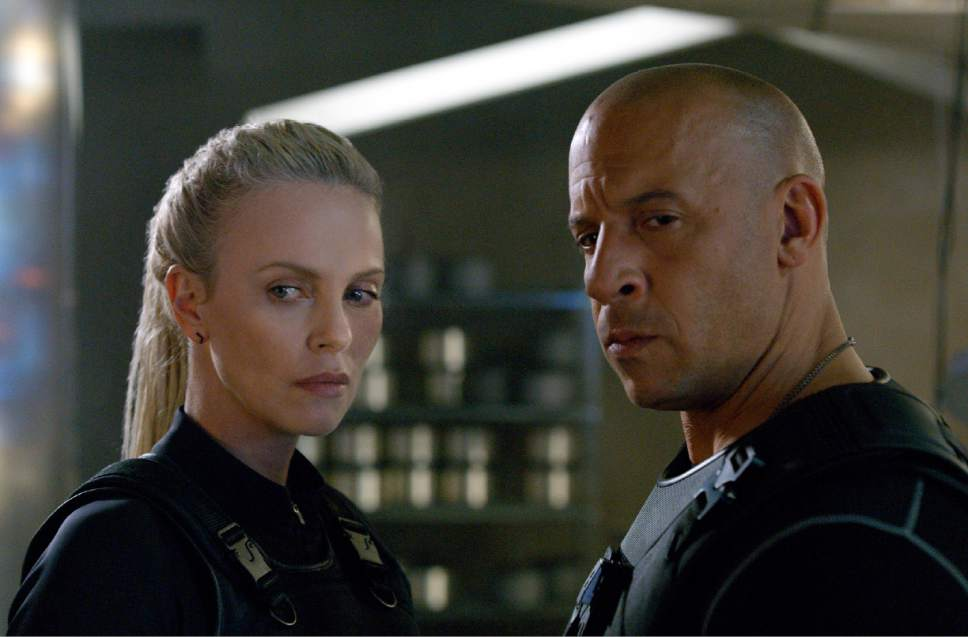 """This image released by Universal Pictures shows Charlize Theron, left, and Vin Diesel in """"The Fate of the Furious."""" (Universal Pictures via AP)"""