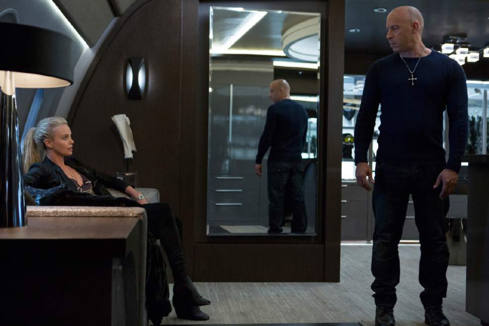 """This image released by Universal Pictures shows Charlize Theron, left, and Vin Diesel in """"The Fate of the Furious."""" (Matt Kennedy/Universal Pictures via AP)"""