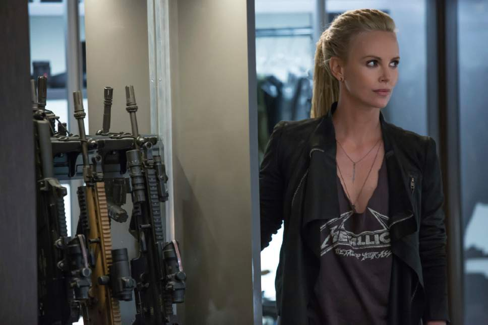 """This image released by Universal Pictures shows Charlize Theron in """"The Fate of the Furious."""" (Matt Kennedy/Universal Pictures via AP)"""
